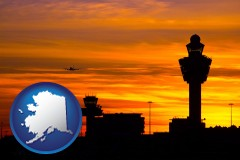 alaska map icon and an airport terminal and control tower at sunset
