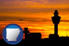 arkansas map icon and an airport terminal and control tower at sunset