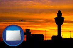 colorado an airport terminal and control tower at sunset