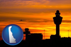 delaware map icon and an airport terminal and control tower at sunset