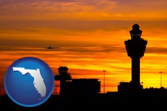 florida map icon and an airport terminal and control tower at sunset