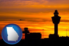 georgia map icon and an airport terminal and control tower at sunset