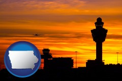 iowa map icon and an airport terminal and control tower at sunset