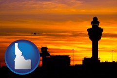 idaho map icon and an airport terminal and control tower at sunset