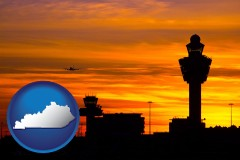 kentucky map icon and an airport terminal and control tower at sunset