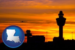louisiana an airport terminal and control tower at sunset