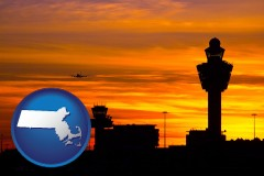 massachusetts map icon and an airport terminal and control tower at sunset