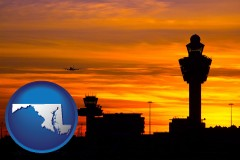 maryland an airport terminal and control tower at sunset