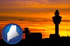 maine map icon and an airport terminal and control tower at sunset
