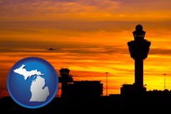 michigan map icon and an airport terminal and control tower at sunset