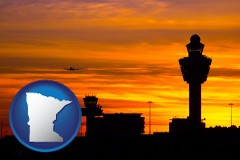 minnesota map icon and an airport terminal and control tower at sunset