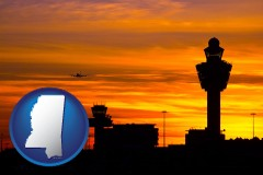 mississippi map icon and an airport terminal and control tower at sunset