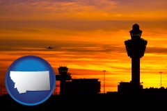montana map icon and an airport terminal and control tower at sunset