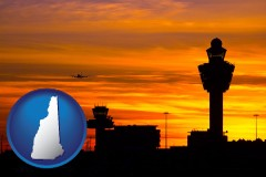 new-hampshire map icon and an airport terminal and control tower at sunset