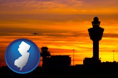 new-jersey map icon and an airport terminal and control tower at sunset