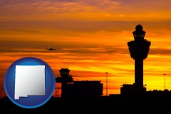 new-mexico map icon and an airport terminal and control tower at sunset
