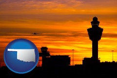 oklahoma map icon and an airport terminal and control tower at sunset
