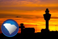 south-carolina map icon and an airport terminal and control tower at sunset