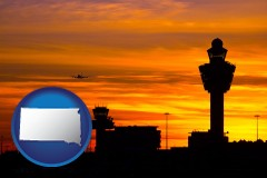 south-dakota map icon and an airport terminal and control tower at sunset