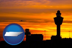 tennessee map icon and an airport terminal and control tower at sunset