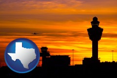 texas an airport terminal and control tower at sunset