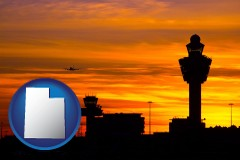utah map icon and an airport terminal and control tower at sunset