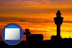 wyoming an airport terminal and control tower at sunset