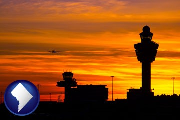 an airport terminal and control tower at sunset - with Washington, DC icon