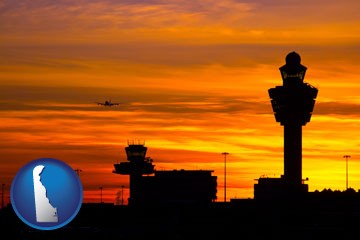 an airport terminal and control tower at sunset - with Delaware icon
