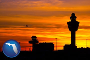 an airport terminal and control tower at sunset - with Florida icon