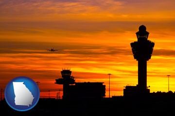 an airport terminal and control tower at sunset - with Georgia icon