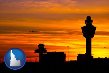 an airport terminal and control tower at sunset - with Idaho icon