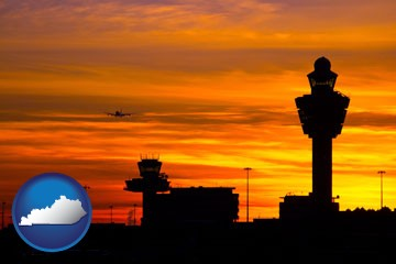 an airport terminal and control tower at sunset - with Kentucky icon