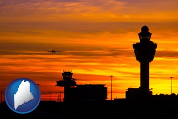 an airport terminal and control tower at sunset - with Maine icon