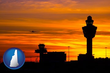 an airport terminal and control tower at sunset - with New Hampshire icon