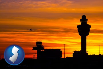 an airport terminal and control tower at sunset - with New Jersey icon