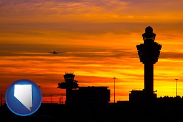 an airport terminal and control tower at sunset - with Nevada icon