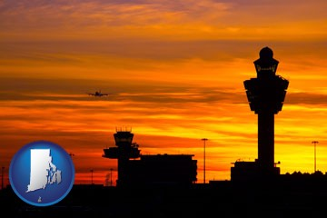 an airport terminal and control tower at sunset - with Rhode Island icon