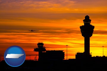 an airport terminal and control tower at sunset - with Tennessee icon