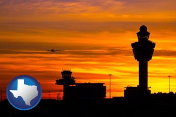an airport terminal and control tower at sunset - with Texas icon