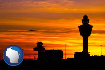 an airport terminal and control tower at sunset - with Wisconsin icon