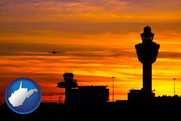 an airport terminal and control tower at sunset - with West Virginia icon